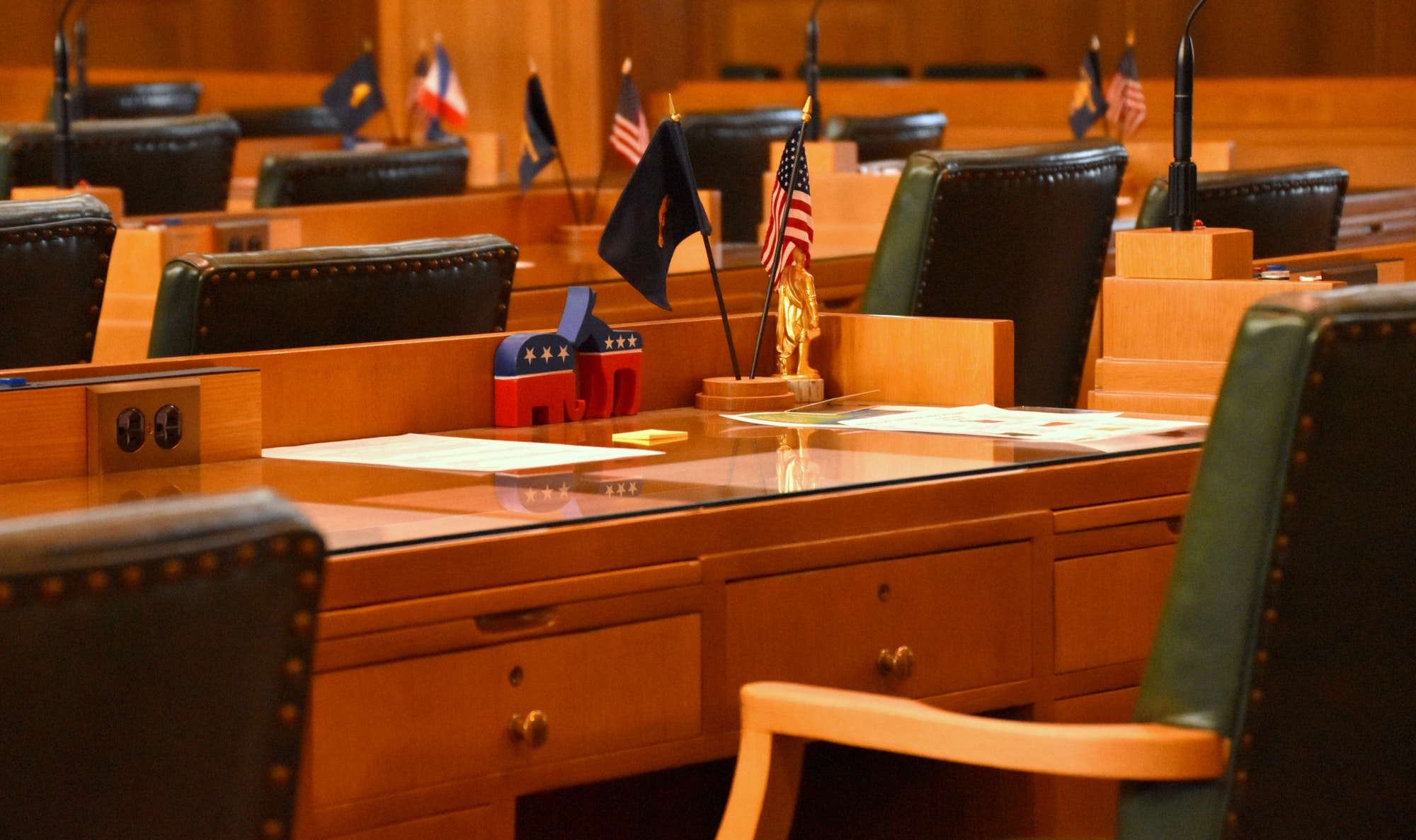 empty government chambers with US flags, republican and democrat symbols